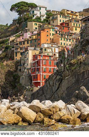 Riomaggiore, Italy - July 8, 2021: Famous Riomaggiore Village With The Multi Colored Houses, Cinque
