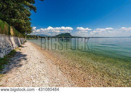 Beautiful Beach On Lake Garda (lago Di Garda) In Front Of The Small Town Of Garda. Promontory Of San