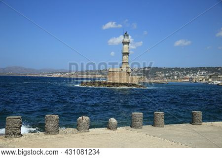 Beautiful View From The Harbor To Venetian Lighthouse In The Port Of Chania On The Northern Coast Of