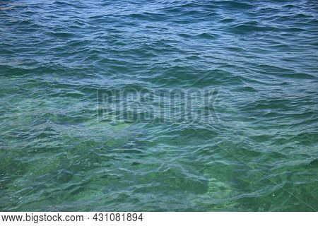 Abstract Blue Water Background. Beautiful Sparkling Clear Sea Water. Clear Sea Water Surface. High Q