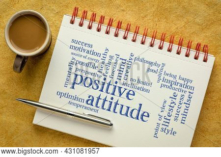 positive attitude word cloud in a spiral notebook with a cup of coffee, mindset and personal development concept
