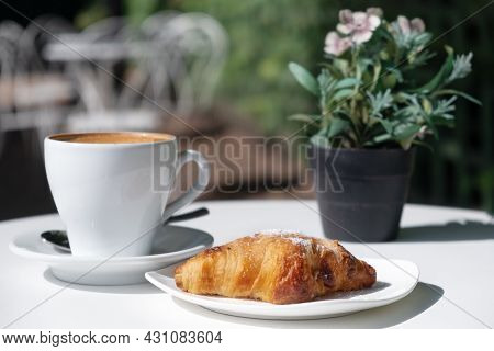 Croissant,cup Of Coffee,flowers On Table In Cafe Outdoors In Street In Sunny Weather.idea Of French