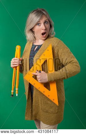 Adult Woman Posing With Compasses And Protractor. Photos On School Subjects. Studio Photo With Chrom