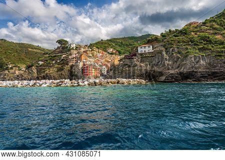 Riomaggiore Village Seen From The Ligurian Sea, Cinque Terre National Park In Liguria, La Spezia, It
