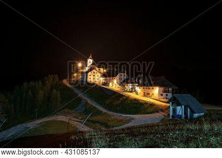 Small And Ancient Village Of Lussari Or Monte Santo Di Lussari (1790 M) At Night, Julian Alps, Campo