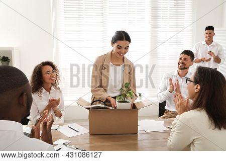 Group Of Coworkers Welcoming New Employee In Team Indoors