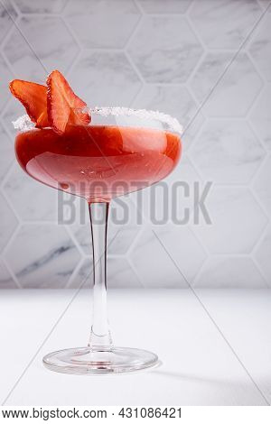 Tropical Fresh Strawberry Juice With Pulp In High Glass Goblet Decorated Sugar Rim, Fruit Slice In M