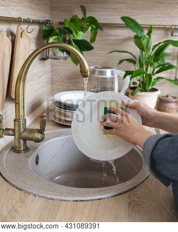 Womens Hands Wash Dishes In Kitchen Sink, Woman Cleans Kitchen And Washes Dishes, Wash