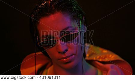 Night Portrait Of Girl And Neon Lights Wearing Down Jacket And Sunglasses In Neon Color Lights . Pre