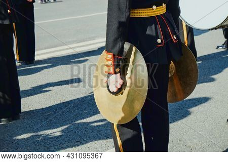 Vintage Brass Hand Cymbals Closeup  In Hands Of Musician Of Military Orchestra.musicians Of The Mili