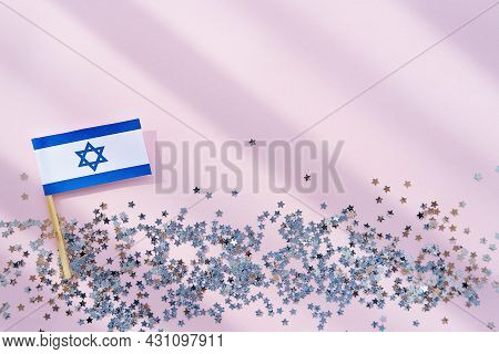 Israel Flag And Sparkles On Pink Background, Flat Lay. Rest In Israel. Happy Israel Independence Day