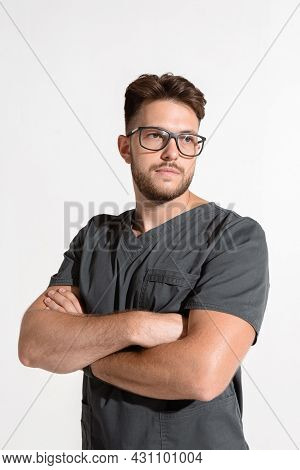 Handsome Serious Professional Young Male With Arms Crossed, Physician Practitioner In Glasses On Whi