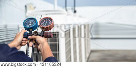 Technician Is Checking Air Conditioner ,measuring Equipment For Filling Air Conditioners , Service A