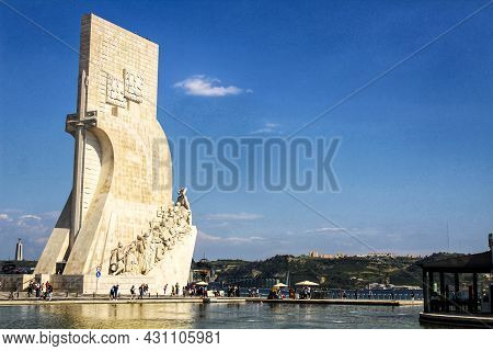 Lisbon, Portugal- 19 May, 2018: People Visiting Discovery Monument In A Sunny Day Next To Tagus Rive