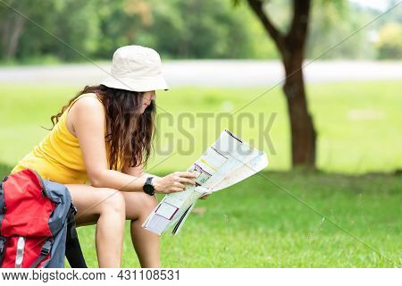 Women Hiker Or Traveler With Backpack Adventure Holding Map To Find Directions And Siting Relax In T