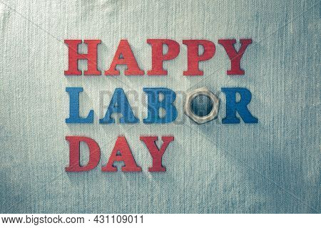 Worn and weathered tools with Happy Labor Day text, celebrating American workers.