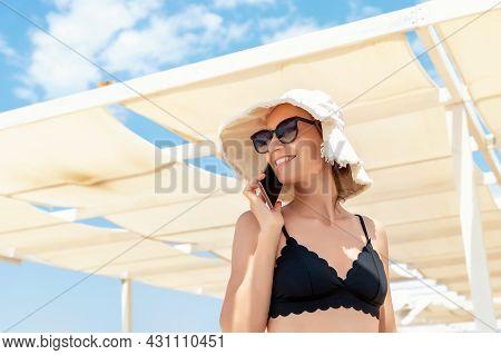 Young Adult Pretty Attractive Woman Wear Bikini, Hat Sunglasses Enjoy Smiling Talking Phone At Tropi