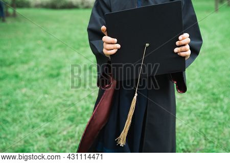 Back To Elementary School Concept. Little Girl Goes To First Grade. Ceremony Of Graduating. Black Go