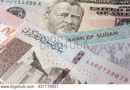 Close Up To 100 Sudanese Pounds Of The Republic Sudan Beside Us Dollars Banknote. 100 Pound Banknote