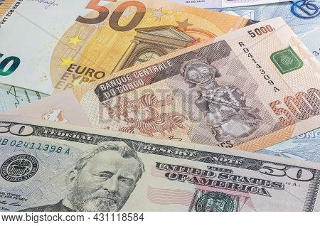 Close Up To 5000 Francs Of The Republic Of Congo Between 50 Us Dollar And 50 Euro Banknotes. Five Th