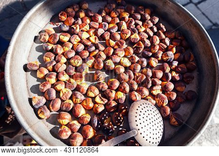 Roasted Chestnuts For Sale On The Street Market . Ballotta And The Caldarrosta . Outdoor Chestnuts R