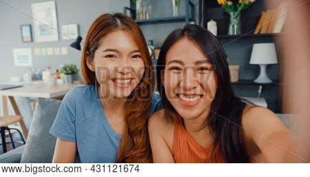 Teenager Asian Women Feeling Happy Smiling Selfie And Looking To Camera While Relax In Living Room A