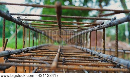 Reinforcing Frame Of The Base Plate. Warehouse For Building Materials For Building A House. Rust And