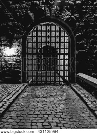 B&w Photo Of A Gateway Entrance To A Medieval Complex In Nyc During Night Time.