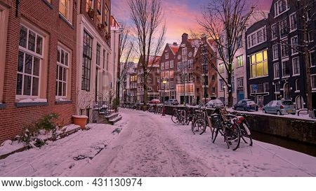 City scenic from snowy Amsterdam in winter in the Netherlands