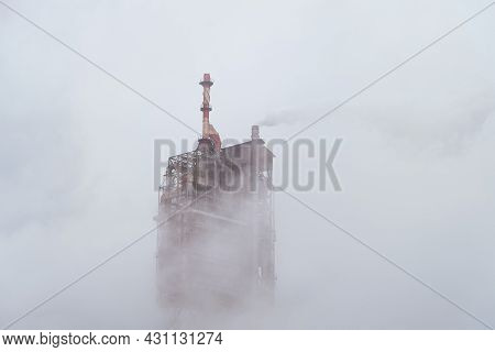 Fuming Chimney Of A Metallurgical Factory. Smog Of Heavy Industry.