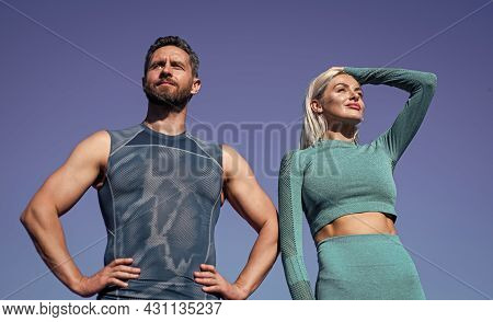 Training With Coach. Muscular Man And Sexy Woman In Sportswear. Athlete People Feel Success. Fitness