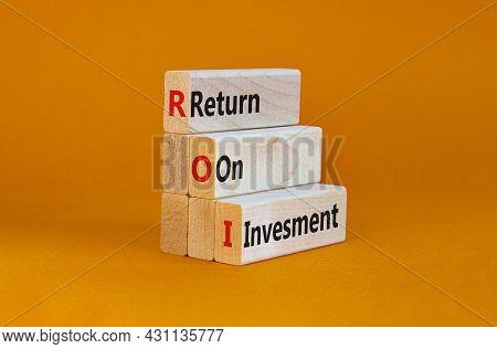 Roi, Return On Investment Symbol. Wooden Blocks With Words 'roi, Return On Investment'. Beautiful Or