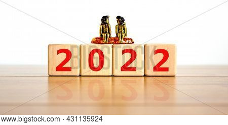 2022 Happy New Year Symbol. Wooden Cubes Symbolize The Change From 2021 To The New Year 2022. Beauti