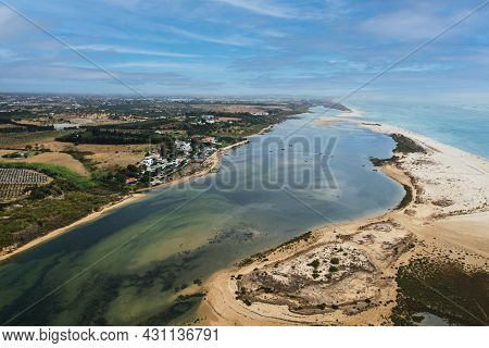 Aerial View Of Praia Da Fabrica, Also Known As Praia De Cacela Velha Beach, A Sandy Barrier Island A