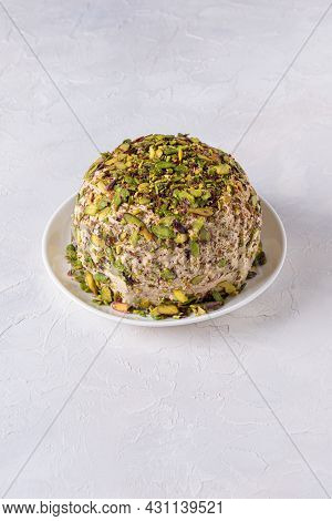Sesame Halva With Pistachios Nuts On White Plate On White Background. High Angle View. Copy Space. T