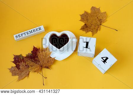 Calendar For September 14 : The Name Of The Month In English, Cubes With The Number 14,a White Heart