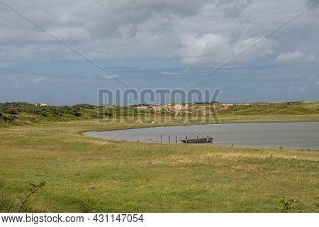Knokke-heist, Flanders, Belgium - August 6, 2021: Zwin Nature Reserve. Green Landscape Of Gray Salt