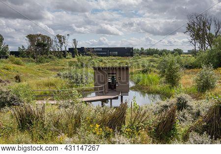Knokke-heist, Flanders, Belgium - August 6, 2021: Zwin Nature Reserve. Lookout Cabin In Pond Surroun