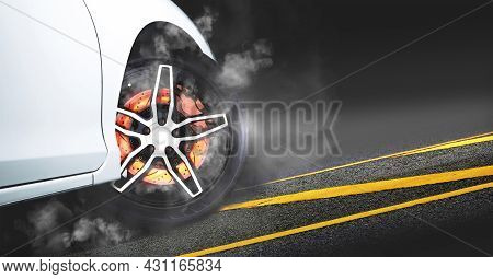 Disc Brakes Burn With High Temperature And The Smoke Of Racing Cars On The Racetrack At Night