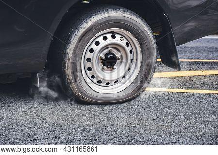 Pickup Truck Flat Tire On The Asphalt Road