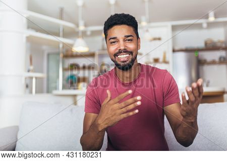 Portrait African American Man Gesturing With Hands At Home.