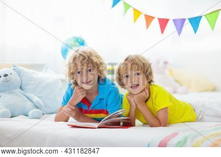 Child Reading In Bed. Kids Read. Boy At Home.