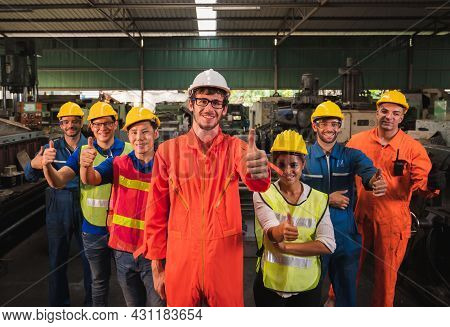 The Industrial Worker Team In A Large Industrial Factory With Many Equipment.