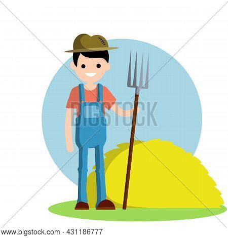 Farmer In Blue Jumpsuit And Hat With Fork In Hands. Yellow Haystack. Kind Of Profession. Rural Boy.