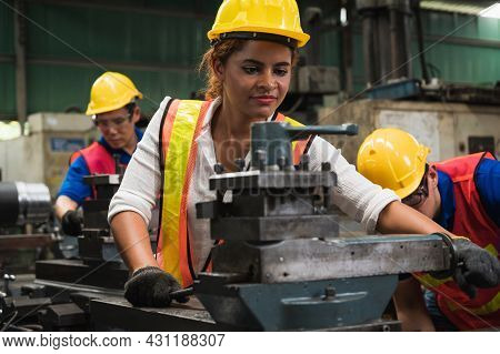 The Industrial Worker Team Is Working On Various Projects In A Large Industrial Factory With Many Eq