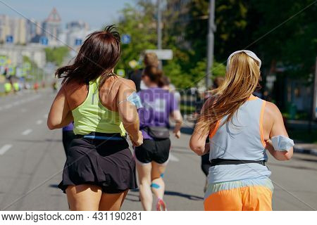 Body Positive Women Running Marathon In City