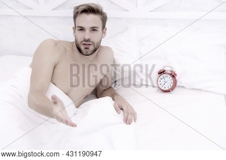 Man Sleeping Bed White Bedclothes And Red Alarm Clock, Morning Awakening Concept