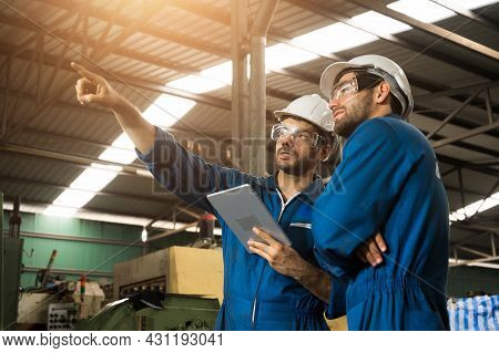 Industrial Workers Are Working On Projects In Large Industrial Plants With Many Devices.