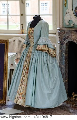 Sogel, Germany - August 25, 2021: Exhibition Of An Historic Dress In Main Building Of Castle Clemens