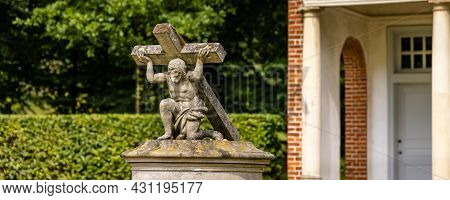 Sogel, Germany - August 25, 2021: Sculpture Of Jesus Carrying His Cross In Cloister Garden At Castle